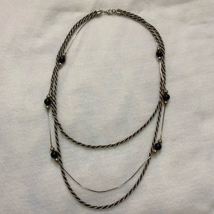 Layered necklace with black and gold chains